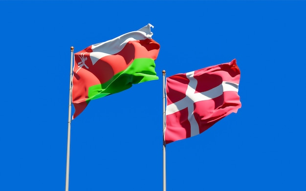 Flags of oman and denmark.