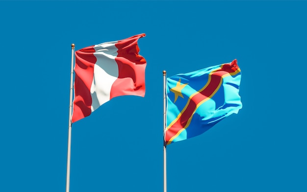 Flags of peru and dr congo on blue sky. 3d artwork