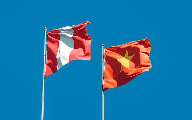 Flags of peru and vietnam on sky background