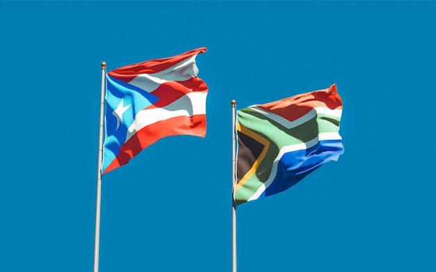 Flags of puerto rico and sar african on blue sky. 3d artwork
