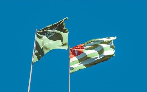 Flags of saudi arabia and abkhazia. 3d artwork