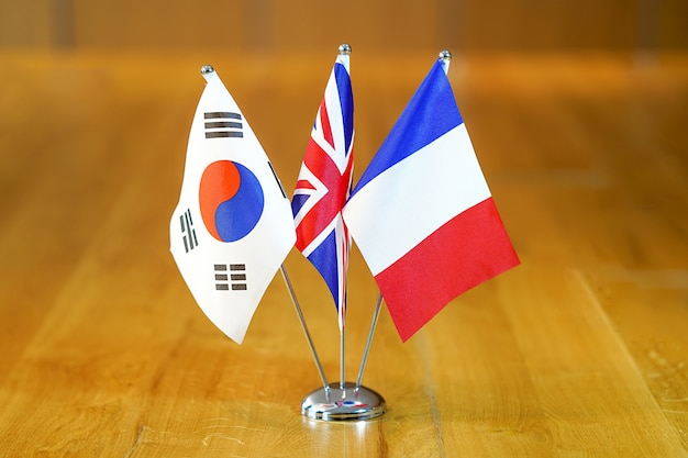 Flags of south korea, uk and france.