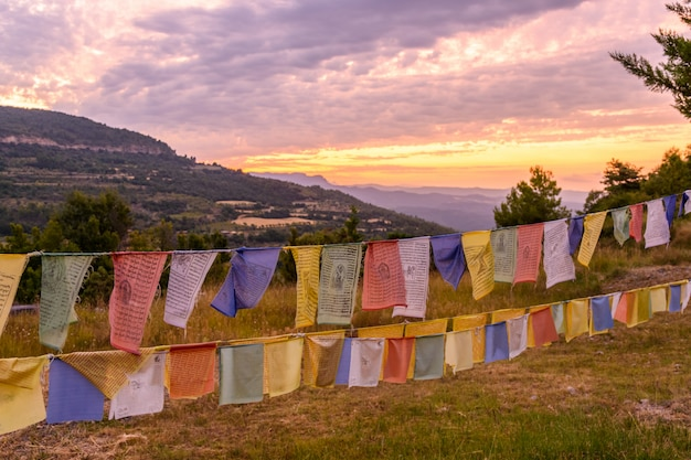 Flags in sunrise in a buddhist temple dag shang kagyu in panillo huesca aragon spain
