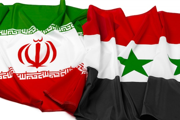 Flags of syria and iran together close up