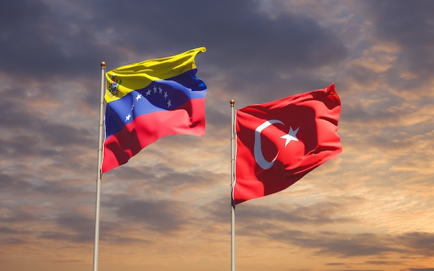 Flags of venezuela and turkey on sky background
