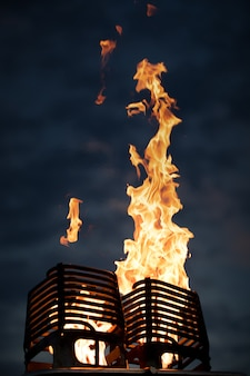 The flame comes from a gas burner, for a balloon. against the background of a dark dawn sky.