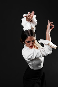 Flamenca with arms up looking down