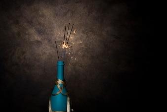 Flaming Bengal lights in bottle ofbeverage