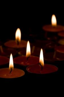 Flaming candles ð¾n the dark background