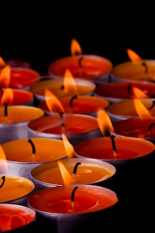 Flaming candles on a black background