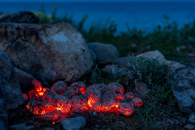 Flaming hot charcoal briquettes, food background or texture