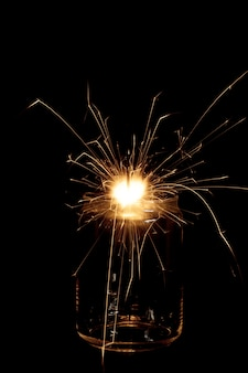 Flaming sparkler in jar