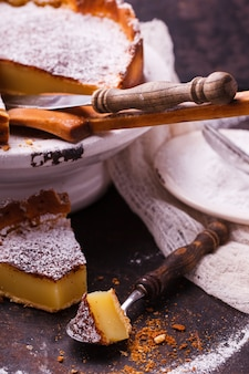 Flan at home, sprinkled with powdered sugar.
