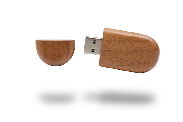 A flash drive in a wooden case on a white background. isolated.