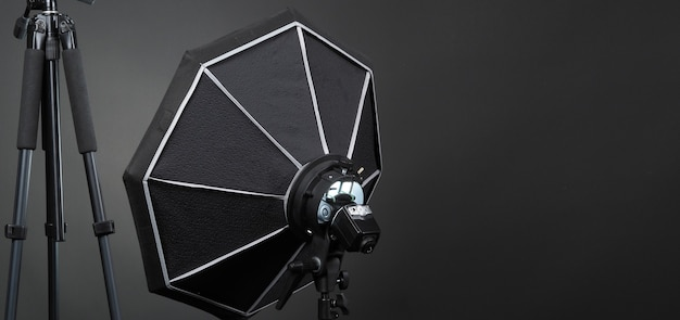 Flash light on tripod in studio production set up for professional photographer shooting photo