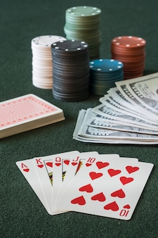 Flash royal poker cards on table, cash and chips