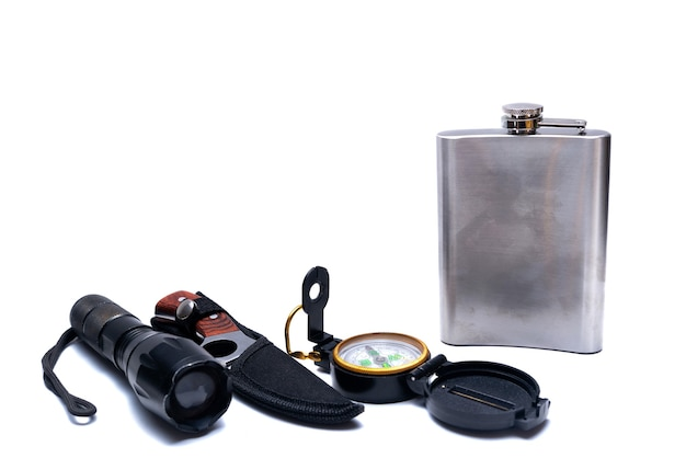Flashlight, compass, knife, flask, tools for survival in the campaign