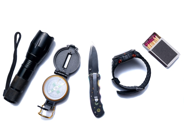 Flashlight, compass, knife, tools for survival in the campaign