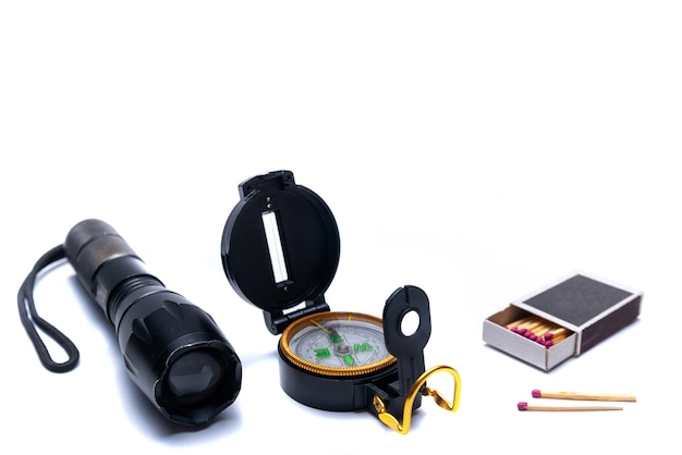 Flashlight, compass, matches, tools for survival in the campaign