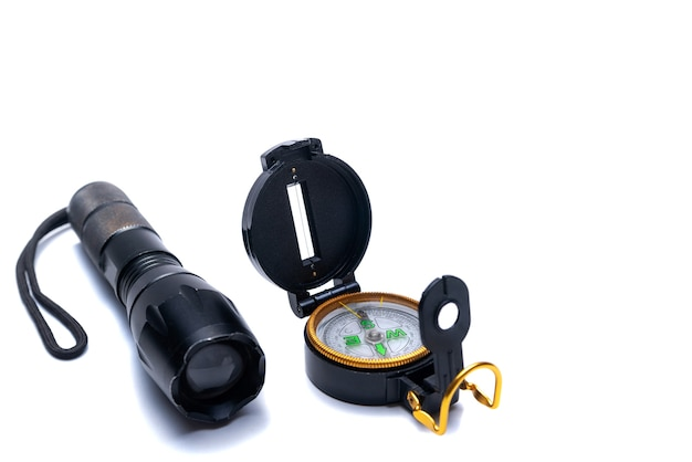 Flashlight, compass, tools for survival in the campaign