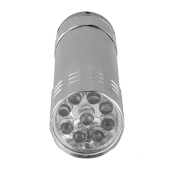 Flashlight small isolated on white wall