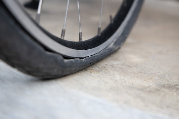 Flat bicycle tire on the street