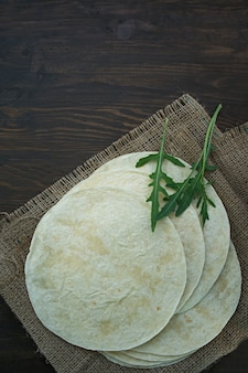 Flat cakes for tacos or burritos. pita bread for making tacos.