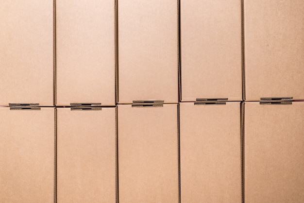 Flat cardboard boxes, textured background