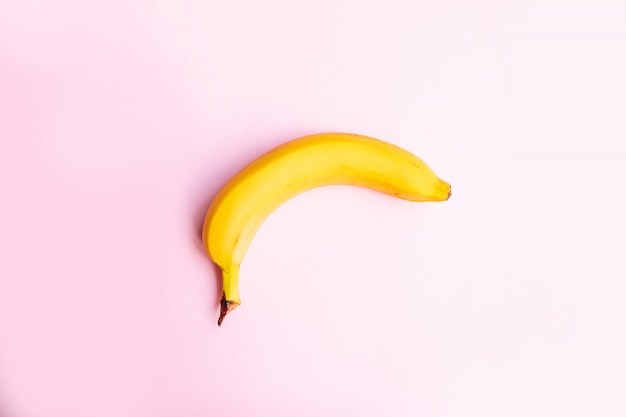 Flat composition  sweet banana on pink background with copy space for your text.