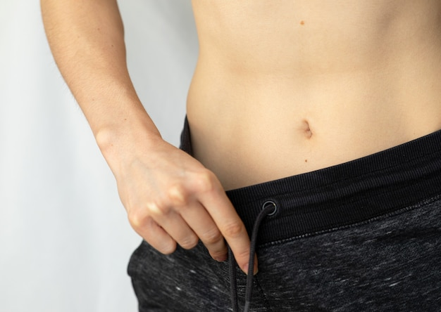 Flat female belly.  woman showing her flat belly.