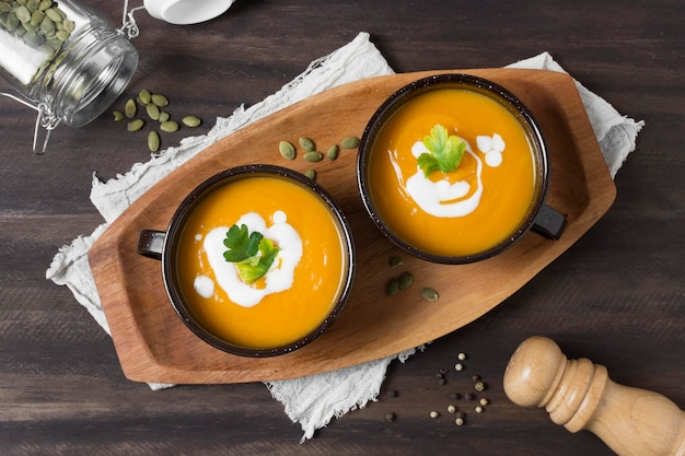 Flat lat bowls with pumpkin soup