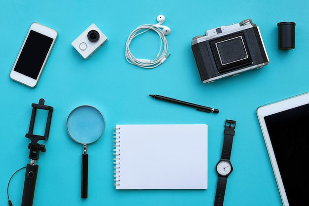 Flat lay of accessories on blue desk background