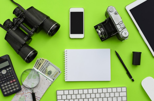 Flat lay of accessories on green desk background