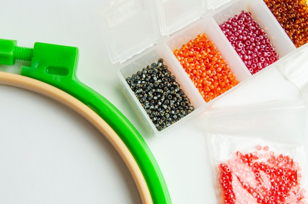 Flat lay accessories for needlework and embroidery, hoops and beads