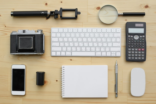 Flat lay of accessories on wooden desk background