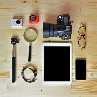 Flat lay of accessories on wooden desk