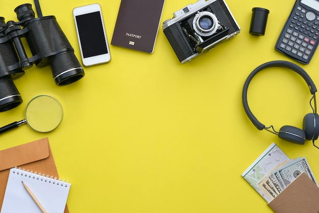 Flat lay of accessories on yellow desk background