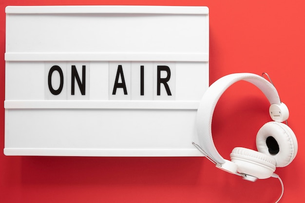 Flat lay on air sign with red background