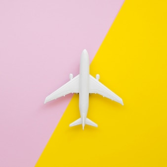 Flat lay airplane toy on table