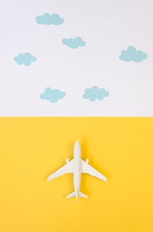 Flat lay airplane toy with clouds