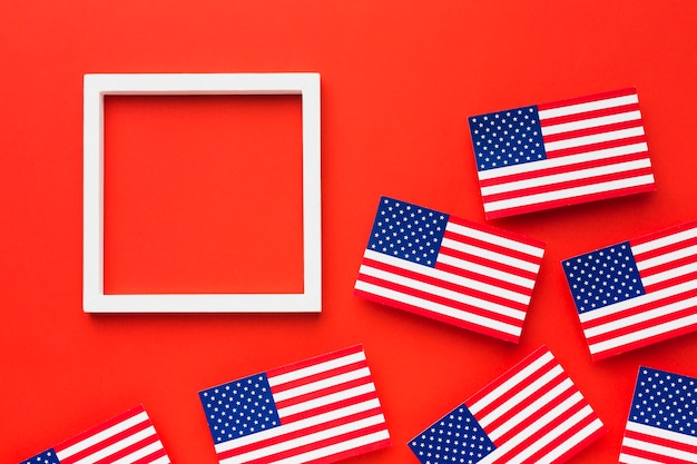 Flat lay of american flags with frame