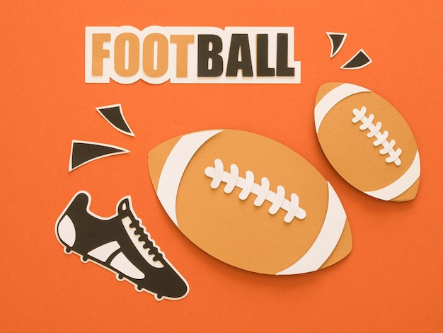 Flat lay of american footballs with sneaker