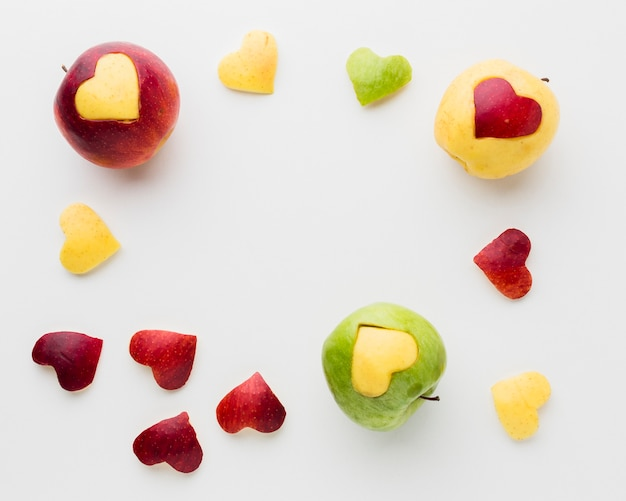 Flat lay of apples and fruit heart shapes