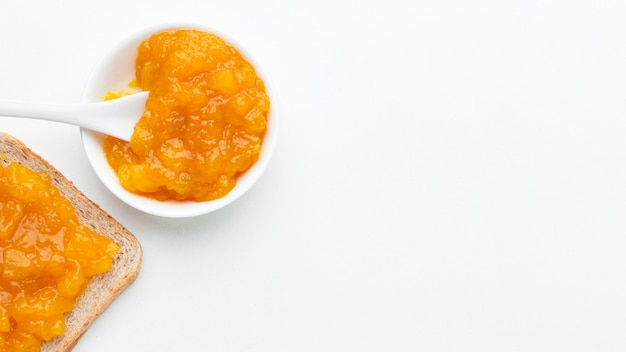 Flat lay apricots jam on bread
