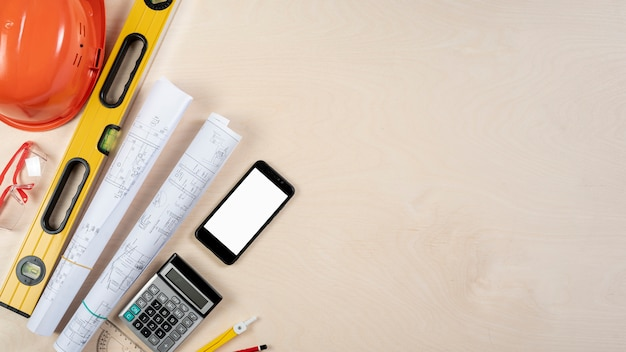 Flat lay of architect desk with phone