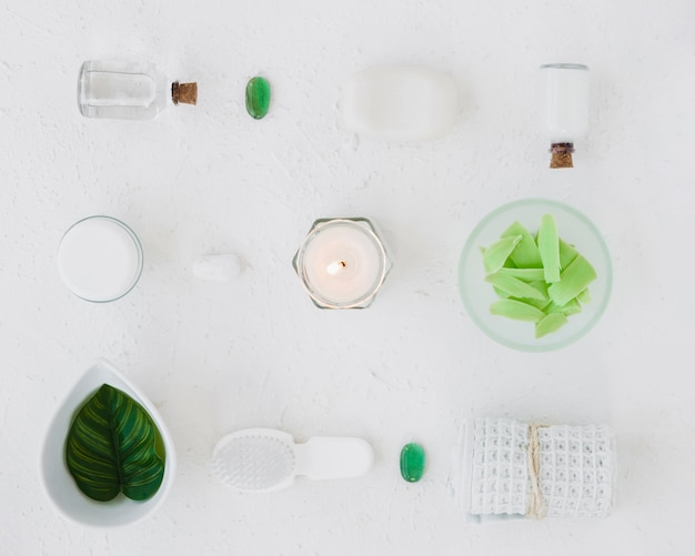 Flat lay arrangement of bath products on white background