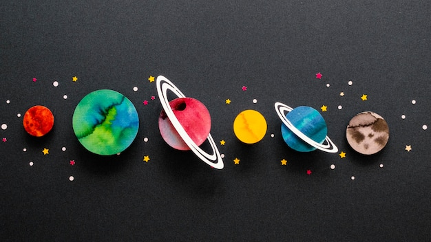 Flat lay arrangement of creative paper planets