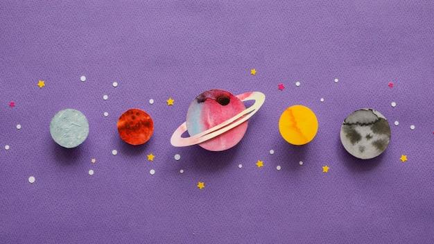 Flat lay arrangement of creative paper planets