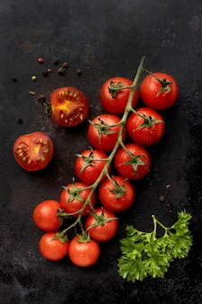 Flat lay arrangement of delicious fresh tomatoes