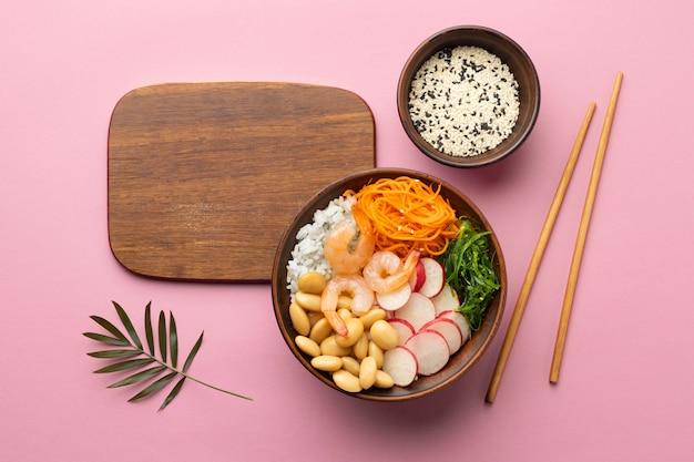 Flat lay arrangement of delicious poke bowl